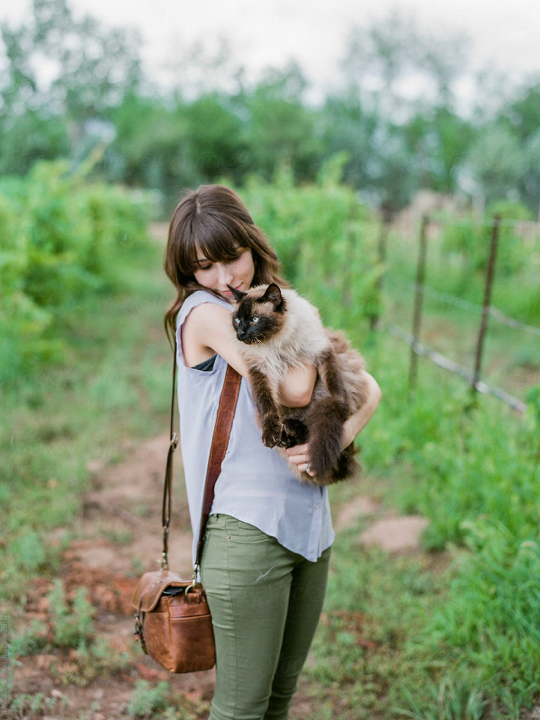 Girl With Cute Cat In Nature